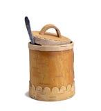 Barril de la miel con la cuchara en el fondo blanco Imagen de archivo libre de regalías