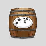 Barril de madera con una imagen de uvas Imagen de archivo libre de regalías
