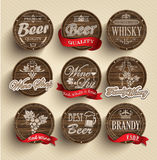 Barriles con los emblemas del alcohol Fotos de archivo libres de regalías