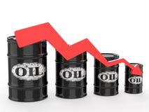 Barriles de aceite con la flecha roja abajo Imagen de archivo libre de regalías