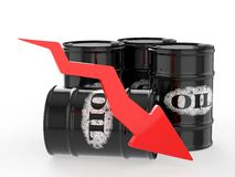 Barriles de aceite con la flecha roja abajo Fotos de archivo