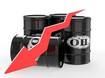 Barriles de aceite con la flecha roja abajo Foto de archivo libre de regalías