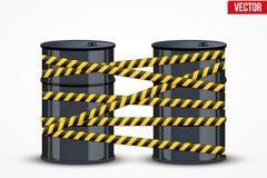 Barriles de aceite con la línea de peligro Fotografía de archivo