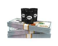 Barriles de aceite en notas del dólar Foto de archivo libre de regalías