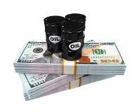 Barriles de aceite en notas del dólar Imágenes de archivo libres de regalías