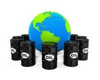 Barriles de aceite y globo de la tierra Foto de archivo libre de regalías