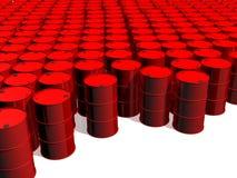 Barriles de petróleo rojos en una tierra blanca Foto de archivo