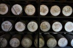 Barriles en una fábrica del ron Imágenes de archivo libres de regalías