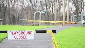Barrington, IL / USA - April 10 2020: Closeup of closed playground sign at park during corona virus pandemic