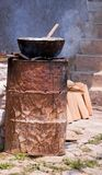 Steaming Tamales Barrio Style. A barrio home with tamales being steamed over a metal drum stove.  Barrio people learn to improvise with whatever is at hand Stock Image