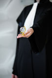 Barrister in robe holding globe in hand Stock Image