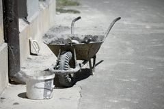 Barrow. Dirty barrow at a construction site royalty free stock images
