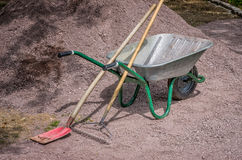 Barrow with shovel and rake Stock Photo