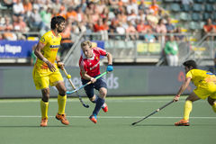 Barry Middleton. THE HAGUE, NETHERLANDS - JUNE 2: English player Barry Middleton (middle) lifts the ball high on his stick, passing Indian player Rupinder at the Stock Image