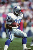 Barry Sanders of the Detroit Lions. Barry Sanders running back sweeping wide looking for a long run stock photo