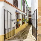 Bars in alleys of Ronda. Some alleys of Ronda install fences as decoration, to the historical set of the city stock photography