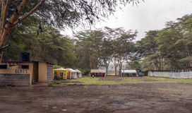 Bars and booths. Located in a camp in Kenya, is surrounded by acacias on a cloudy day Stock Images