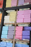 Bars of colored soap on a local market in B�doin Stock Photos