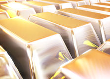 Bars of gold. Shiny gold bars stacked in rows. Image with shallow depth of field and soft flash Stock Images