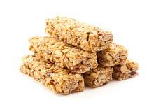 bars granola isolerad staplad white royaltyfri fotografi
