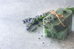 Bars of handmade soap with lavender flowers over neutral stone b stock photo