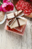 Bars of handmade soap and other natural cosmetics. In the background royalty free stock photos