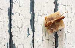 Bars of handmade soap over white grunge wood background Royalty Free Stock Photos