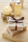Bars of handmade soap, scented candle and bottles with liquid so royalty free stock photo