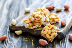 Bars of honey and peanuts. Royalty Free Stock Images