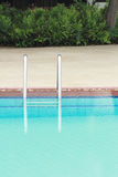 Bars ladder in the  pool Stock Photo