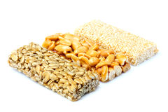 Bars with peanuts, sesame and sunflower seeds. Royalty Free Stock Photo