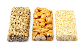Bars with peanuts, sesame and sunflower seeds isolated. Royalty Free Stock Images