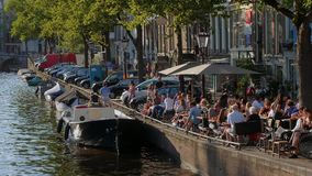 The bars and restaurants at the canals of Amsterdam - a great place to relax - Amsterdam - The Netherlands - July 19. The bars and restaurants at the canals of stock video
