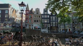The bars and restaurants at the canals of Amsterdam - a great place to relax. Amsterdam - Holland stock video