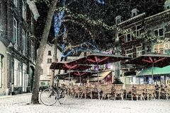 Bars and restaurants with snow and christmas lights on the Sint stock photo