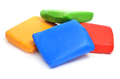 Rolled fondant. Bars of rolled fondant of different colors on a white background royalty free stock photography