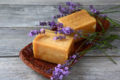 Bars of soap and lavender flowers Stock Images