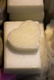 Bars of soap in the shape of colorful heart royalty free stock images