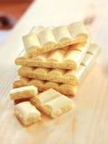 Bars of white porous chocolate Stock Photos