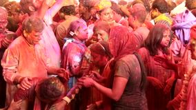 Barsana, India - 20180223 - Holi Festival  -  woman dancer is startled by paint in eyes but keeps dancing2. stock video