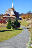 Barsana monastery alley. Barsana monastery in maramures, northern transylvania in romania. Curved stairs to wooden house Stock Photo