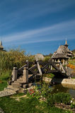 Barsana Orthodox Monastery. A view of a monastery buildings with distinctive spires and a bridge over a small river at the Barsana Monastery in Romania Stock Photo