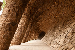 Barselona, Park Guell, hte perspective of unique colonnade by Antonio Gaudi. Barcelona, Catalan, Catalonia, Spain, famous angled colonnade perspective by Antonio Stock Image