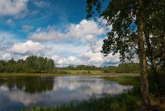 Barskiy Pond. Beautiful cloudscape scene near the pond Stock Images
