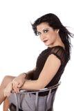 Barstool della donna che osserva sopra la spalla Immagine Stock Libera da Diritti