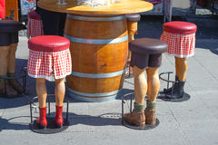 Barstool in the form of human legs, funny .. Royalty Free Stock Photos