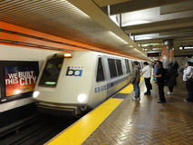 BART Train Speeds Into Station Platform With People Waiting And Stock Images