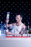 Bartender. Is smiling and mixing coctail Stock Photos