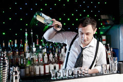 Bartender. Is pouring a drink Royalty Free Stock Images