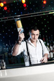 Bartender. Is smiling and looking at the camera Stock Image